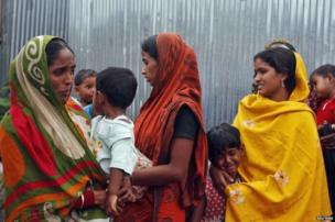Villagers from Muslim communities affected by ethnic violence weep at a relief camp in Baksa district in the northeastern Indian state of Assam.