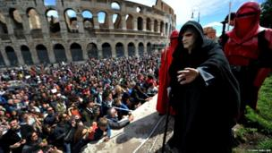 Members of the Star Wars fan club celebrate Star Wars Day in front of the Colosseum in central Rome