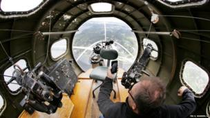 A guest on a media flight takes a photograph of Lake Washington from the front gun turret of a B-17 Flying Fortress bomber