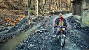 A man on a motorbike