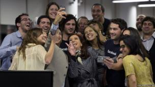 Argentine President Cristina Fernandez de Kirchner (centre) poses for a selfie with workers of Facebook Argentina
