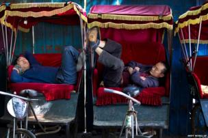 Chinese trishaw drivers take nap