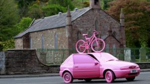 Pink car and bike.