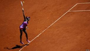 Sloane Stephens of the US serves the ball to Li Na of China during their match at the Madrid Open tennis tournament - 8 May 2014