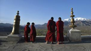 Young Buddhist monks play traditional instruments on the roof of Thikse Monastery in Ladakh, India - 7 May 2014