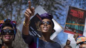 """Women protesting with posters reading """"Bring Back Our Girls"""" outside the Nigerian consulate in Johannesburg, South Africa - Thursday 8 May 2014"""