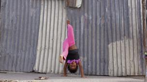 A girl doing a handstand, Khayelitsha, South Africa - Tuesday 6 May 2014
