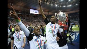 Senegalese midfielder Moustapha Diallo (R) holds the Coupe de France trophy at a stadium in Saint-Denis, France - Saturday 3 May 2014