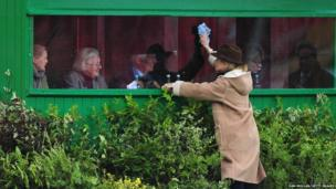 The windows of the judge's cabin at the Badminton Horse Trials are cleaned
