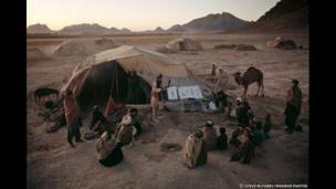 Men attend mine awareness program in Kandahar, 1992