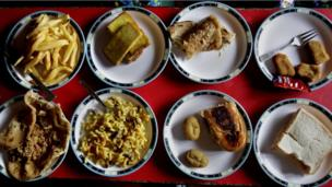 Assorted lunch plates are arranged at a table for students at the Bahria Foundation school in Rawalpindi, Pakistan.