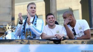 Joe Hart, James Milner and Vincent Kompany on top of bus
