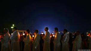 Pilgrims attend a candlelight vigil at the Catholic shrine of Fatima in central Portugal