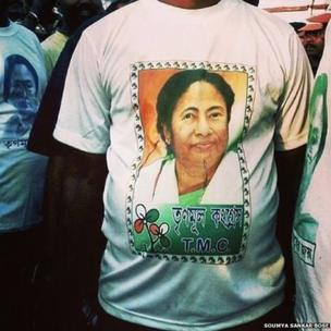 A Trinamool Congress Party supporter attends an election rally in Sonarpore wearing a Mamata Banerjee T-shirt.
