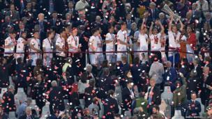Sevilla's Croatian midfielder Ivan Rakitic raises the trophy