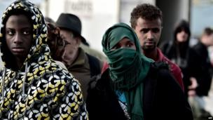 A group of migrants from Somalia arrive at the port of Piraeus in Athens on 12 May 2014
