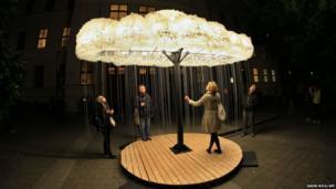People test a piece of art named Cloud in Brno, Czech Republic