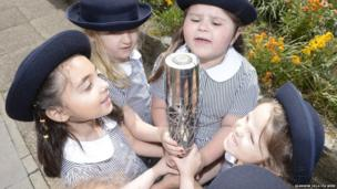 School children from Market Square Preparatory School Reception year holding The Commonwealth Baton as it makes its way around the Isle of Man.