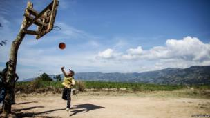 A boy plays in a basketball located in the mountainous region of Corillera, North of Metro Manila, Philippines.