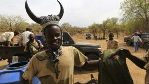 Sudanese troops, one with a horn headdress, celebrate in South Kordofan, Sudan - Tuesday 20 May 2014