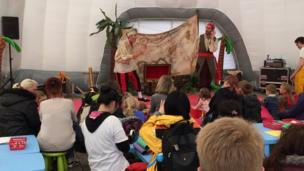 Stars of CBeebies programme 'Swashbuckle' performing on stage