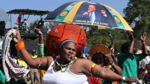 A woman dances in Pretoria, South Africa, on 24 May 2014