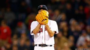 Koji Uehara of the Boston Red Sox pitches against the Atlanta Braves