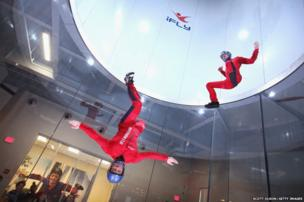 Instructors Derek Vanboeschoter (left) and David Schnaible demonstrate wind-tunnel flying at the iFly indoor skydiving facility in Rosemont, Illinois