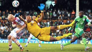 Nigeria's goalkeeper Austin Ejide vies with Scotland's striker Steven Naismith