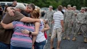US soldier Wesley Freeman (centre) is embraced by his family
