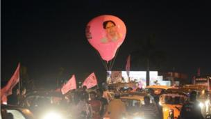 Indian supporters of Telangana hold a balloon with an image of Telangana Rashtra Samiti (TRS) president K Chandrasekhar Rao during celebrations of India's 29th state, Telangana, in Hyderabad early on June 2, 2014