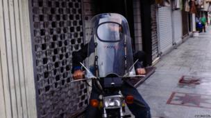 A motorcyclist in Iran's capital, Tehran