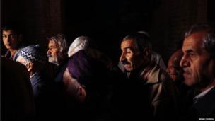 Men leave the Dar Al Ihsan Mosque in Sanandaj