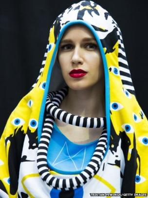 A model poses backstage before the Best of Graduate Fashion Week