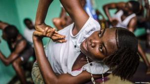 A yoga participant in Sierra Leone