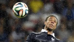 Loic Remy of France jumps for the ball