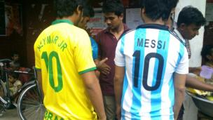Bengali football fans wearing Brazil and Argentina shirts
