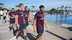 England players walk by hotel pool