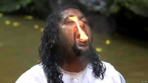 Camphor burns on the tongue of a devotee in the Ganga Dhaaraa festival at Blanchisseuse on Trinidad's north coast. 8 June 2014