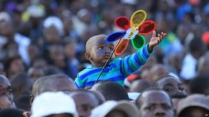 A child holding a flower toy in Harare, Zimbabwe - Saturday 7 June 2014