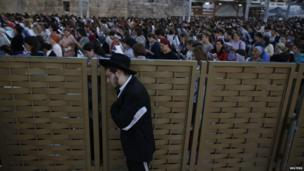 "Israelis take part in a mass prayer at the Western Wall, Judaism""s holiest prayer site, in Jerusalem""s Old City, for the return of three teenagers who were abducted June 15, 2014"