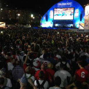 Fans watch England v Italy in the 2014 World Cup at a fans area on Copacabana beach