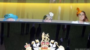 Queen Elizabeth II, Princess Eugenie and Princess Beatrice take a peek at the races during Royal Ascot
