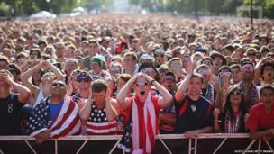 Fans gather in Grant Park to watch the US play Portugal in a Group G World Cup soccer match on 22 June 2014 in Chicago, Illinois.