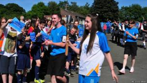 Newbattle student Abby arrives with the Queen's Baton.