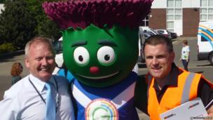 Head teacher Mr Taylor and event organiser Mr Wilson with Commonwealth mascot Clyde.