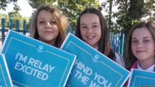 Newbattle High School girls hold signs in support