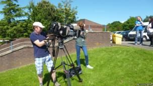 BBC News crew set up for filming.
