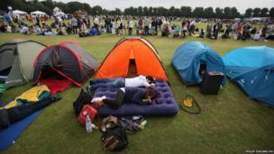 Spectators begin to queue having camped overnight tickets to the Wimbledon Tennis Championships