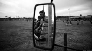 Villagers watch players train